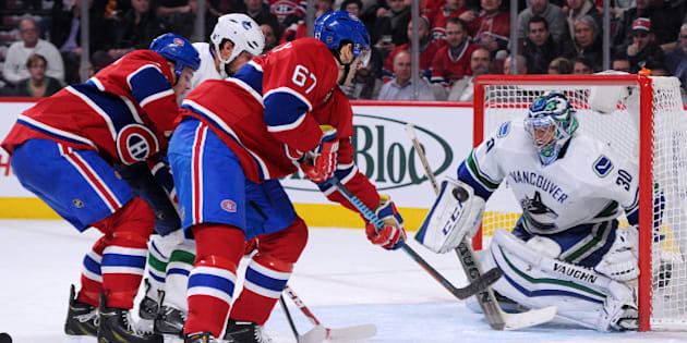 MONTREAL, QC - DECEMBER 9: Max Pacioretty #67 of the Montreal Canadiens shoots the puck on Ryan Miller #30 of the Vancouver Canucks during the NHL game at the Bell Centre on December 9, 2014 in Montreal, Quebec, Canada.   (Photo by Richard Wolowicz/Getty Images)