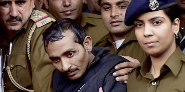 32-year-old Shiv Kumar Yadav, center, a driver from the international taxi-booking service Uber, is surrounded by police as he is brought out after being produced in a court in New Delhi, India, Monday, Dec. 8, 2014. The court ordered Yadav be held for three days for police questioning over allegations that he raped a finance company employee after being hired to ferry her home from a dinner engagement on Friday night. (AP Photo/Press Trust of India)INDIA OUT