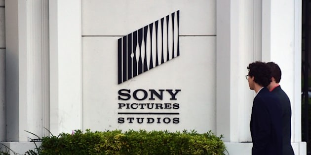 Pedestrians walk past an exterior wall to Sony Pictures Studios in Los Angeles, California on December 4, 2014, a day after Sony Pictures denounced a 'brazen' cyber attack it said netted a 'large amount' of confidential information, including movies as well as personnel and business files, But downplaying a report that North Korea was behind the attack, saying it did not yet know the full extent of the 'malicious' security breach.  AFP PHOTO/Frederic J. BROWN        (Photo credit should read FREDERIC J. BROWN/AFP/Getty Images)