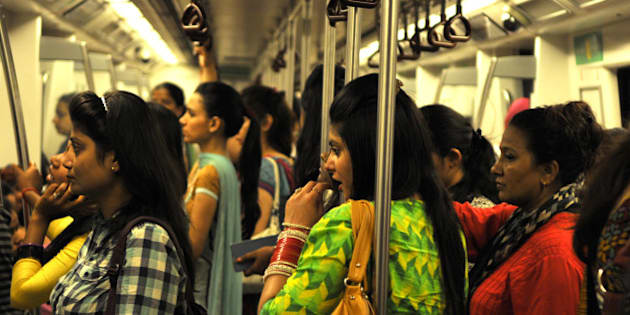 NEW DELHI, INDIA - JUNE 26: Indian women travel inside a Women Only metro train compartment after the inauguration of Mandi House-Central Secretariat line on June 26, 2014 in New Delhi, India.  Over two million commuters use the Delhi Metro in the Indian capital daily. The new 3.2 kilometers route is estimated to benefit 70,000 commuters. (Photo by Sonu Mehta/Hindustan Times via Getty Images)