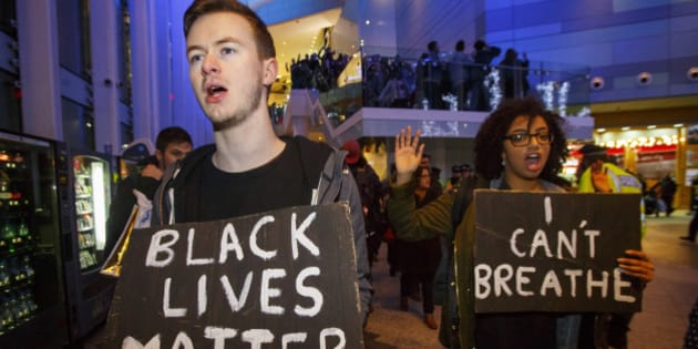 LONDON, UNITED KINGDOM - DECEMBER 10:  Hundreds of people demonstrate outside White City Westfield Shopping Centre in London, England on December 10, 2014 during a protest after two grand juries decided not to indict the police officers involved in the deaths of Michael Brown in Ferguson, Mo. and Eric Garner in New York, N.Y. (Photo by Tolga Akmen/Anadolu Agency/Getty Images)