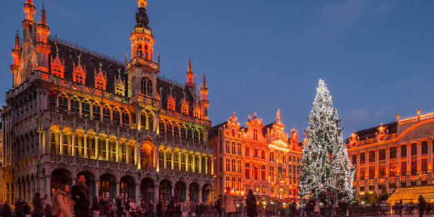 A giant Christmas tree and a light show decorate the Grand Place in Brussels, Wednesday, Dec. 12, 2014. The Christmas tree is a gift of Riga, capital city of Latvia and European cultural capital 2014. This exceptional Christmas tree measures 22 meters (72 feet), one of the highest to have adorned the Grand Place, and is one of the many attractions the Brussels' Christmas market has to offer. (AP Photo/Geert Vanden Wijngaert)