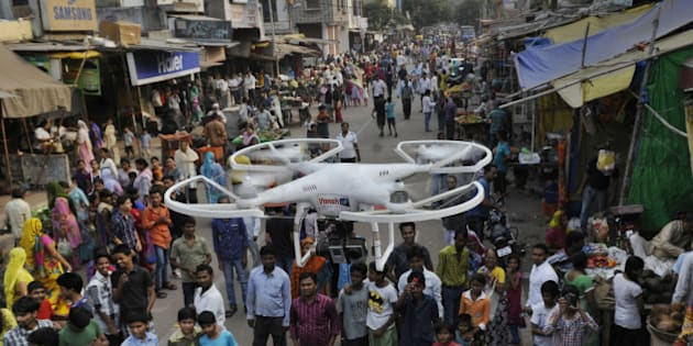 NEW DELHI, INDIA - OCTOBER 28: Delhi Police has deployed camera-equipped drones for surveillance in riot affected areas of Trilokpuri on October 28, 2014 in New Delhi, India. The prohibitory orders on gathering and movement of people imposed in East Delhi Trilokpuri area following a communal clash were relaxed for three hours as no fresh violence was reported. (Photo by Mohd Zakir/Hindustan Times via Getty Images)