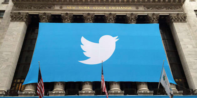 A banner with the Twitter Inc. logo hangs outside the New York Stock Exchange (NYSE) in New York, U.S., on Thursday, Nov. 7, 2013. Twitter Inc. raised $1.82 billion in its initial public offering, seizing on surging investor demand to price at a more expensive valuation than rival Facebook Inc. Photographer: Scott Eells/Bloomberg via Getty Images