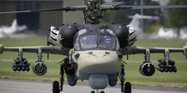 A KA-52 military helicopter, manufactured by Kamov, a unit of OAO Russian Helicopters, taxis after landing on the second day of the Paris Air Show in Paris, France, on Tuesday, June 18, 2013. The 50th International Paris Air Show is the world's largest aviation and space industry show, and takes place at Le Bourget airport June 17-23. Photographer: Chris Ratcliffe/Bloomberg via Getty Images