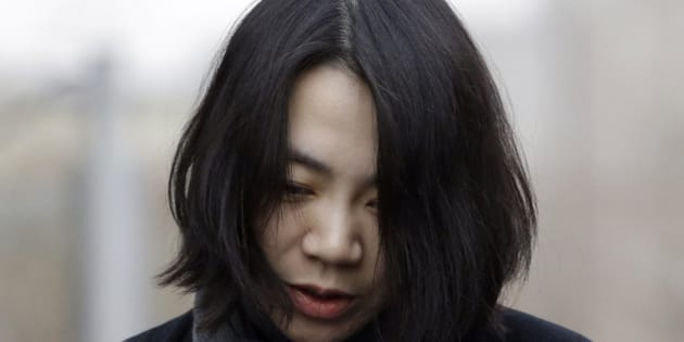 """Cho Hyun-ah, who was head of cabin service at Korean Air and the oldest child of Korean Air chairman Cho Yang-ho, speaks to the media upon her arrival for questioning at the Aviation and Railway Accident Investigation Board office of Ministry of Land, Infrastructure and Transport in Seoul, South Korea, Friday, Dec. 12, 2014. The chairman of Korean Air Lines Co. apologized Friday for the behavior of his adult daughter who delayed a flight in an incident now dubbed """"nut rage."""" (AP Photo/Lee Jin-man)"""
