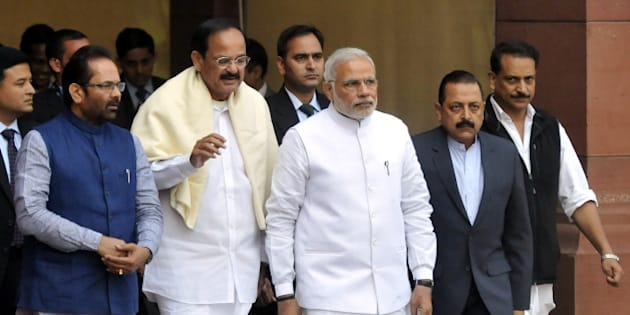 NEW DELHI, INDIA- NOVEMBER 24: Prime Minister Narendra Modi walks with Union Minister of State for Parliamentary Affairs & Minority Affairs Mukhtar Abbas Naqvi, Minister of Urban Development and Parliamentary Affairs Venkaiah Naidu, Minister of State Skill Development & Entrepreneurship (Independent Charge) Rajiv Pratap Rudy, Dr. Jitendra Singh Minister of Science and Technology during the opening day of the winter session of Parliament on November 24, 2014 in New Delhi, India. The Narendra Modi government, which has promised big reforms in its first budget, is looking to push the Insurance Bill as well as the Goods and Service Tax Bill in the month-long winter session that begins today. (Photo by Vipin Kumar/ Hindustan Times via Getty Images)