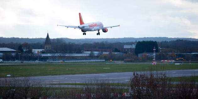 An Easyjet plane lands at Gatwick Airport in southern England on December 7, 2013. A 'technical problem' in Britain's air traffic control systems caused widespread flight delays and cancellations across the country's airspace. AFP PHOTO/CARL COURT        (Photo credit should read CARL COURT/AFP/Getty Images)