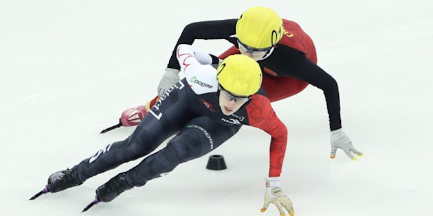 SHANGHAI, CHINA - DECEMBER 13:  Marianna St-Gelais of Canada and Liu Yang of China compete in the Ladies 500M Quarterfinals during the ISU World Cup Short Track Speed Skating 2014/15 - Shanghai at Oriental Sports Center on December 13, 2014 in Shanghai, China.  (Photo by Chung Sung-Jun - ISU/ISU via Getty Images)