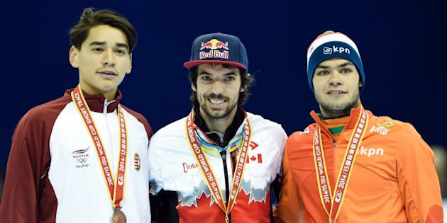 (L-R) Bronze medalist Hungary's Shaolin Sandor Liu, gold medalist Canada's Charles Hamelin and bronze medalist the Netherland's Sjinkie Knegt (2nd) pose during the awards ceremony after the men's 1000 metre final at the ISU World Cup Short Track speed skating event in Shanghai on December 14, 2014. AFP PHOTO / JOHANNES EISELE        (Photo credit should read JOHANNES EISELE/AFP/Getty Images)