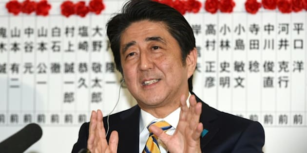 Japanese Prime Minister and ruling Liberal Democratic Party (LDP) president Shinzo Abe answers a question during a television interview at the party headquarters in Tokyo on December 14, 2014.  Japanese Prime Minister Shinzo Abe won comfortable re-election December 14 in a snap poll he had billed as a referendum on his economic policies after early success faded into a recession.      AFP PHOTO / TOSHIFUMI KITAMURA        (Photo credit should read TOSHIFUMI KITAMURA/AFP/Getty Images)