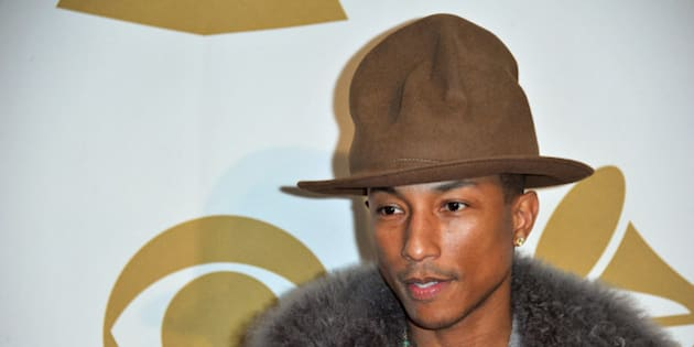 Pharrell Williams arrives at the night that changed America: a Grammy salute to the Beatles, on Monday, Jan. 27, 2014, in Los Angeles. (Photo by Richard Shotwell/Invision/AP)