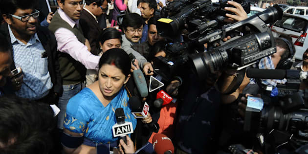 NEW DELHI, INDIA- NOVEMBER 24: Smriti Irani, Union Minister of HRD talking to media personnel during the opening day of the winter session of Parliament on November 24, 2014 in New Delhi, India. The Narendra Modi government, which has promised big reforms in its first budget, is looking to push the Insurance Bill as well as the Goods and Service Tax Bill in the month-long winter session that begins today. (Photo by Vipin Kumar/ Hindustan Times via Getty Images)