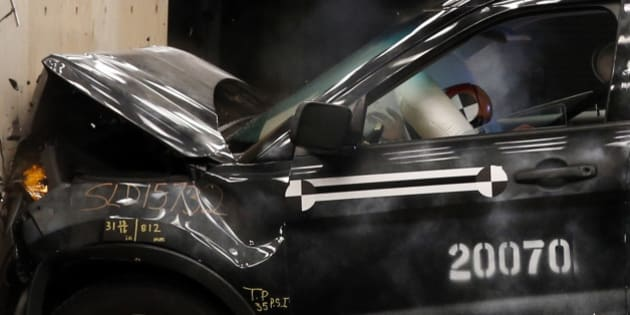 A crash test dummy's head hits the airbag in a Ford Motor Co. 2014 Explorer XLT during a head on 30 mile per hour crash test at the company's Crash Barrier Facility and Safety Laboratory at Ford's Proving Grounds in Dearborn, Michigan, U.S., on Monday, March 10, 2014. Ford, which recently completed it's 20,000 crash test at the Dearborn facility, is increasing its investment in computing power by fifty percent in order to conduct crash tests and retrieve data from them more quickly. Photographer: Jeff Kowalsky/Bloomberg via Getty Images