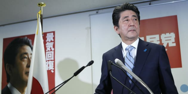 Shinzo Abe, Japan's prime minister and president of the ruling Liberal Democratic Party (LDP), stands for a photograph as he arrives for a news conference at the party's headquarters in Tokyo, Japan, on Monday, Dec. 15, 2014. Prime Minister Shinzo Abe claimed a mandate for his economic program after his gamble on early elections paid off with a sweeping victory that forced the leader of the opposition to resign. Photographer: Kiyoshi Ota/Bloomberg via Getty Images