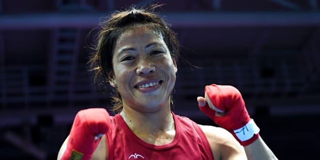 Gold medallist India's Hmangte Chungneijang Mary Kom reacts after being declared the winner of the women's flyweight (48-51kg) boxing final match against Kazakhstan's Shekerbekova Zhaina during the 2014 Asian Games at the Seonhak Gymnasium in Incheon on October 1, 2014. AFP PHOTO/ INDRANIL MUKHERJEE        (Photo credit should read INDRANIL MUKHERJEE/AFP/Getty Images)