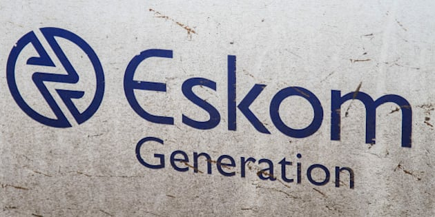 An Eskom Generation sign sits on display at the Grootvlei power station, operated by Eskom Holdings SOC Ltd., in Grootvlei, South Africa, on Monday, Nov. 3, 2014. Eskom said South Africa's power supply remains strained as it investigates what caused a silo storing coal to collapse, forcing the state-owned utility to cut electricity to customers. Photographer: Dean Hutton/Bloomberg via Getty Images