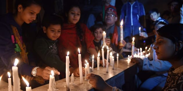 Activists of Pakistan Tehreek e Insaaf (PTI) light candles for the victims of an attack by Taliban gunmen on a school in Peshawar, in Karachi on December 16, 2014. Taliban insurgents killed at least 130 people, most of them children, after storming an army-run school in one of Pakistan's bloodiest ever attacks. AFP PHOTO / Asif HASSAN        (Photo credit should read ASIF HASSAN/AFP/Getty Images)