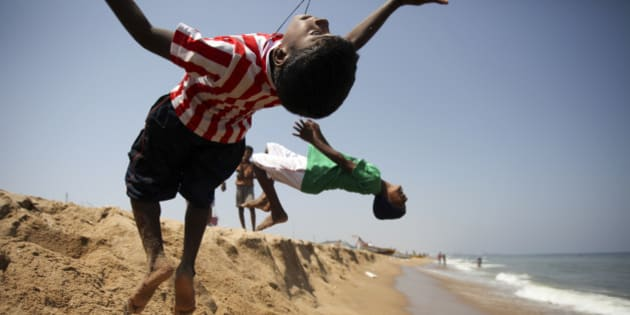 """This photo was taken in March 2013 on Marina Beach in Chennai, INDIA. The beach is like the main street of the city here where all people gather at different moments of the day for different purposes. Those kids were just playing while the brothers seemed to be fishing. They doing this trick again and again just for fun.  <a href=""""http://www.cheese-naan.fr"""" rel=""""nofollow"""">www.cheese-naan.fr</a>"""