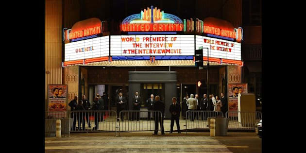 Security is seen outside The Theatre at Ace Hotel before the premiere of the film 'The Interview'  in Los Angeles, California on December 11, 2014.  The film, starring US actors Seth Rogen and James Franco, is a  comedy about a CIA plot to assassinate its leader Kim Jong-Un, played by Randall Park.  North Korea has vowed 'merciless retaliation' against what it calls a 'wanton act of terror' -- although it has denied involvement in a massive cyber attack on Sony Pictures, the studio behind the film.                    AFP PHOTO/STR        (Photo credit should read -/AFP/Getty Images)
