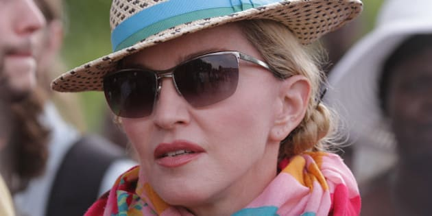 U.S singer Madonna arrives in Kasungu, about 150 kilometers north of the capital Lilongwe, Sunday, Nov. 30, 2014. Madonna is currently visiting Malawi with her son David and daughter Mercy, where she has been working since 2006 with her non profit organization, Raising Malawi. (AP Photo/Tsvangirayi Mukwazhi)