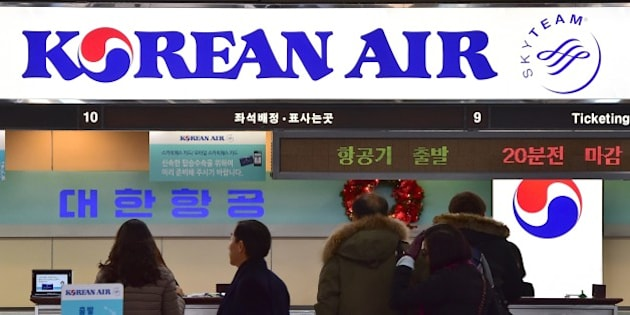 Travelers are seen at the Korean Air ticketing desk at Gimpo airport in Seoul on December 16, 2014. South Korea said it could fine Korean Air up to 2 million USD after the daughter of its chief executive delayed a flight by throwing a tantrum over some nuts. AFP PHOTO / JUNG YEON-JE        (Photo credit should read JUNG YEON-JE/AFP/Getty Images)