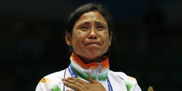 India's L. Sarita Devi cries after she refused her bronze medal during the medal ceremony for the women's light 60-kilogram division boxing at the 17th Asian Games in Incheon, South Korea, Wednesday, Oct. 1, 2014.  India's protest against the outcome of an Asian Games boxing semifinal that was awarded to South Korea's Park Ji-na over Devi in the women's 60-kilogram division was rejected on Tuesday. Devi rejected her medal in protest against the result. (AP Photo/Kin Cheung)