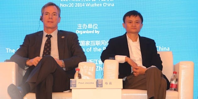 WUZHEN, CHINA - NOVEMBER 20: (CHINA OUT) Paul Jacob (L), chairman and CEO of Qualcomm, and Jack Ma, chairman and CEO of Alibaba Group, attend 2014 World Internet Conference on November 20, 2014 in Wuzhen, Zhejiang province of China. The first World Internet Conference is being held in Wuzhen from November 19 to November 21.  (Photo by ChinaFotoPress/ChinaFotoPress via Getty Images)