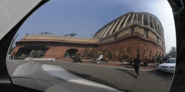 NEW DELHI, INDIA - DECEMBER 16: A View of Parliament house during the Parliament Winter Session on December 16, 2014 in New Delhi, India. Lok Sabha passed a bill to regularise unauthorized colonies and rehabilitate slum dwellers in poll-bound Delhi.( Photo by Sonu Mehta/Hindustan Times via Getty Images)