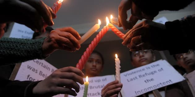 Indian schoolchildren hold placards and candles as they pay tribute to Pakistan children and staff killed in a Taliban attack on a school in Peshawar, at a school in Amritsar on December 17, 2014.  Pakistan began three days of mourning on December 17 for the 132 schoolchildren and nine staff killed by the Taliban in the country's deadliest ever terror attack as the world united in a chorus of revulsion.    AFP PHOTO/NARINDER NANU        (Photo credit should read NARINDER NANU/AFP/Getty Images)