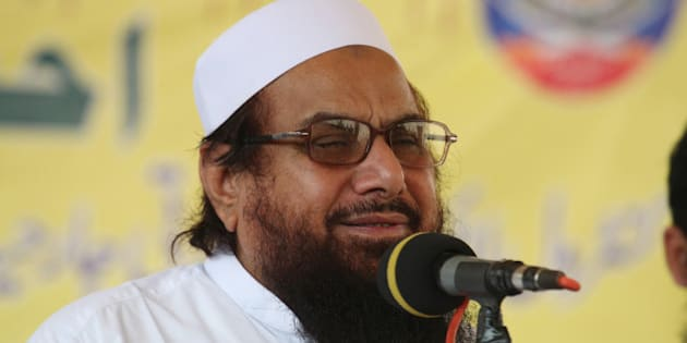 Hafiz Saeed, the leader of anti-Indian group Jammatud Dawa, addresses a rally against India, Friday, Oct. 10, 2014 in Lahore, Pakistan. Fighting in Kashmir between India and Pakistan subsided on Friday as Pakistan's Prime Minister Nawaz Sharif met with advisers and military chiefs to discuss the latest spasm of violence in the disputed Himalayan region, which has killed at least 21 civilians over the past week. (AP Photo/K.M. Chaudary)