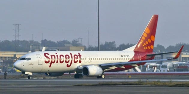 FILE – In this Friday, Jan 26, 2007 file photo, a SpiceJet aircraft taxies on the runway at the airport in New Delhi, India. Low-cost Indian airline SpiceJet has grounded all flights after oil companies stopped supplies of jet fuel to the financially beleaguered carrier. No SpiceJet flights had taken off Wednesday, Dec. 17, 2014, Press Trust of India reported. (AP Photo/Mustafa Quraishi, File)