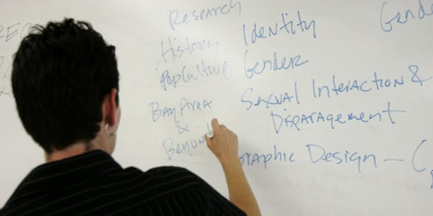 Professor Jennifer Reck writes on the board while lecturing during a Queer Cultures and Society class at San Francsico State University in San Francisco, Wednesday, Aug. 29, 2007. Even as scholars continue to debate the academic merit of gay and lesbian studies, more and more universities are offering students the chance to take courses in Queer Art History, Chicana Lesbian Literature and Sexual Orientation and the Law. Helping fuel the rise of specialized degree programs are endowments from gay alumni and demands from students who are coming out of the closet at younger ages. (AP Photo/Jeff Chiu)