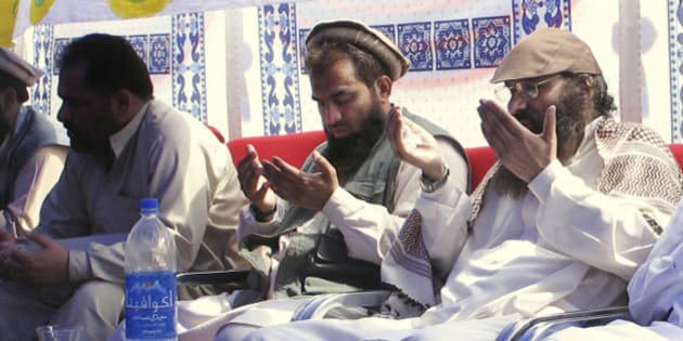 An alleged plotter of Mumbai attacks, Pakistani Zaki-ur-Rehman Lakhvi, center, prays with Syed Salahuddin, right, chief of Hezbul Mujahedeen, or United Jehad Council, at a rally on Saturday, June 28, 2008, in Muzaffarabad, capital of Pakistani Kashmir. Pakistan has detained Zarrar Shah, another alleged mastermind of the Mumbai terrorist attacks, Pakistani Prime Minister Yousuf Raza Gilani confirmed Wednesday, Dec. 10, 2008, apparently making good on pledges to pursue the perpetrators. (AP Photo/Roshan Mughal)