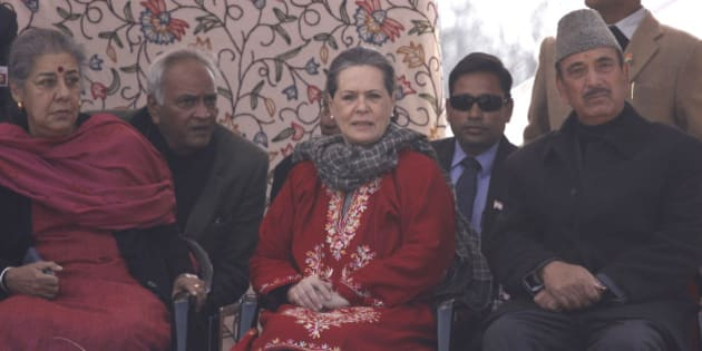 SRINAGAR, INDIA - DECEMBER 10: Congress President Sonia Gandhi along with former Union Ministers Ghulam Nabi Azad and Ambika Soni during an election rally at Roni Pora Sangus constituency on December 10, 2014 in Anantnag some 75 Kms from Srinagar, India. Congress president said that it was easy to showcase dreams, but the Congress party actually worked for the development of everyone without any kind of bias. (Photo by Waseem Andrabi/Hindustan Times via Getty Images)