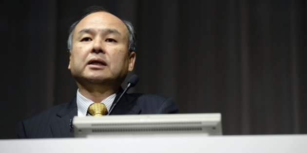 Billionaire Masayoshi Son, chairman and chief executive officer of SoftBank Corp., speaks during a news conference in Tokyo, Japan, on Tuesday, Nov. 4, 2014. SoftBank is forecasting its first profit drop in at least nine years as Sons goal of creating the worlds largest wireless carrier stalls on losses at Sprint Corp. Photographer: Akio Kon/Bloomberg via Getty Images