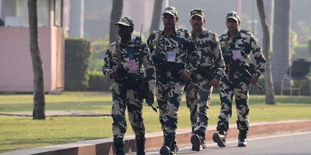 Indian security personnel patrol during the opening of the winter session of Parliament in New Delhi on November 24, 2014. The Narendra Modi government, which has promised big reforms in its first budget, is looking to push the Insurance Bill as well as the Goods and Service Tax Bill in the month-long winter session that begins today. AFP PHOTO/ Prakash SINGH        (Photo credit should read PRAKASH SINGH/AFP/Getty Images)