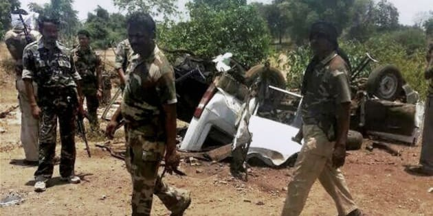 Indian security personnel walk past the debris of a police vehicle blown up by suspected Maoist rebels in Gadchiroli district, Maharashtra, India, Sunday, May 11, 2014. Authorities say leftist rebels detonated a land mine under the police vehicle and killed seven officers in the central jungles of India. The officers had been part of a special force tasked with flushing the Maoist rebels out of their strongholds in the states of Maharashtra and Chhattisgarh. (AP Photo)