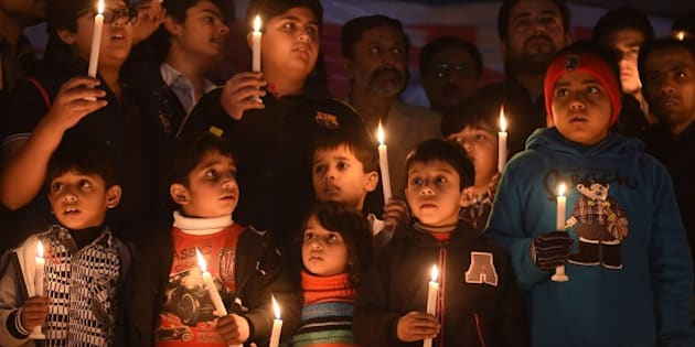 Pakistani political party workers, traders and students light candles during a vigil in Islamabad on December 18, 2014, for the children and teachers killed in an attack by Taliban militants on an army-run school in Peshawar. Pakistan is mourning 148 people -- mostly children -- killed by the Taliban in a school massacre that prompted global revulsion and put the government under new pressure to combat the scourge of militancy. AFP PHOTO / Farooq NAEEM        (Photo credit should read FAROOQ NAEEM/AFP/Getty Images)