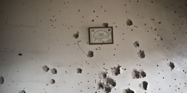 A wall shows bullet marks inside the Army Public School, attacked Tuesday by Taliban gunmen in Peshawar, Pakistan, Thursday, Dec. 18, 2014. The Taliban massacre that killed more than 140 people, mostly children, at the military-run school in northwestern Pakistan left a scene of heart-wrenching devastation, pools of blood and young lives snuffed out as the nation mourned and mass funerals for the victims got underway. (AP Photo/Muhammed Muheisen)