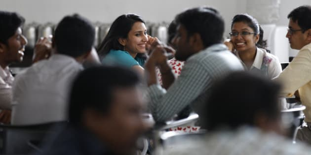 Titan Company employees interact during a break at their corporate office in Bangalore, India, Tuesday, Oct. 28, 2014. Indian women still face some of the world's worst inequality in access to health care, education and work, despite years of rapid economic growth, according to the annual Gender Gap Index by the Geneva-based World Economic Forum released Tuesday. India ranked an impressive 15th for female political participation, but it was among the bottom 20 in terms of income, literacy, work force participation and infant survival. (AP Photo/Aijaz Rahi)