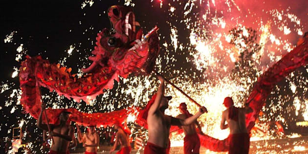 This picture taken on February 14, 2014 shows Chinese villagers perform a dragon dance to celebrate the lantern festival in Yongchuan, Chongqing municipality.  The Lunar New Year festival ended on February 14 with the lantern festival, and also coinciding with Valentine's Day.         CHINA OUT      AFP PHOTO        (Photo credit should read STR/AFP/Getty Images)