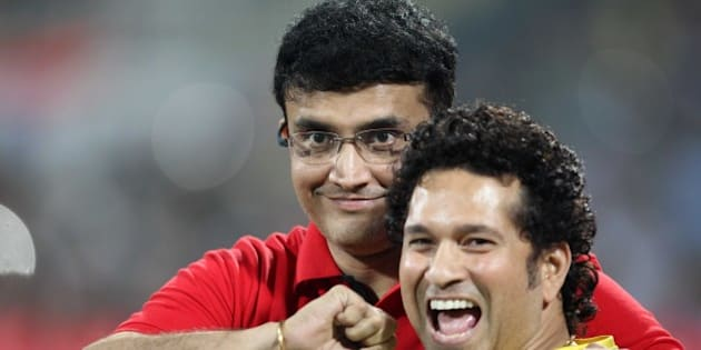 MUMBAI, INDIA - DECEMBER 20: Sachin Tendulkar of Mumbai City FC (Blue) and Sourav Ganguly of Atletico De Kolkata (White) during a closing ceremony of Indian Super League football tournament after final football match between Mumbai City FC (Blue) and Atletico De Kolkata (White) at DY Patil Stadium on December 20, 2014 in Mumbai, India. (Photo by Satish Bate/Hindustan Times via Getty Images)