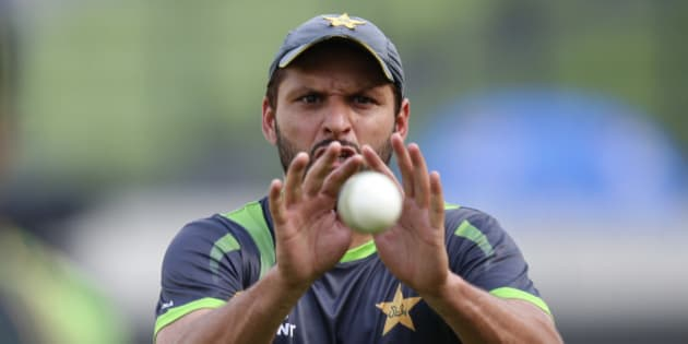 Pakistan's Shahid Afridi prepares to catch the ball during a training session ahead of their ICC Twenty20 Cricket World Cup match against India in Dhaka, Bangladesh, Thursday, March 20, 2014. (AP Photo/Aijaz Rahi)