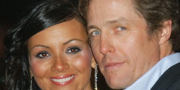 British actor Hugh Grant and co-star Martine McCutcheon arrive at the European premiere of their latest film, Love Actually, at a cinema in London's Leicester Square Sunday Nov. 16, 2003. (AP Photo/Max Nash)