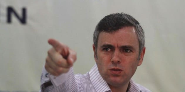 Jammu and Kashmir state Chief Minister Omar Abdullah gestures as he addresses a press conference in Srinagar, India, as sporadic clashes between Hindus and Muslims continue for a third day in the Indian portion of Kashmir, Sunday, Aug. 11, 2013. Abdullah appealed to people for calm and said no politician would be allowed to visit Kishtwar and other violence-hit towns until normalcy was restored. (AP Photo/Mukhtar Khan)