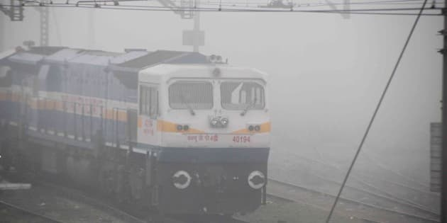 ALLAHABAD, INDIA - 2014/12/22: A train running slow during a cold and foggy morning. Train time departure and arrival are not followed due to the foggy situation in railways. (Photo by Amar Deep/Pacific Press/LightRocket via Getty Images)