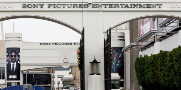 """FILE - In this Thursday, Dec. 18, 2014 file photo, banners of blockbuster films as """"Men In Black,"""" """"Batman"""" and """"Annie"""" are displayed at the entrance of Sony Pictures Entertainment studio lot in Culver City, Calif.. Faced with rising cybercrime like the attack on Sony Pictures Entertainment, companies worldwide are under pressure to tighten security but are hampered by cost and, for some, reluctance to believe they are in danger. (AP Photo/Damian Dovarganes, File)"""