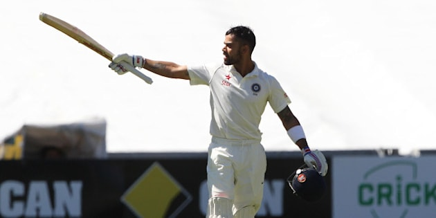 India's Virat Kohli reacts after reaching a century during the final day of their cricket test match against Australia in Adelaide, Australia, Saturday, Dec. 13, 2014. (AP Photo/James Elsby)