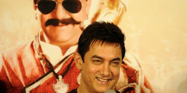 NOIDA, INDIA - NOVEMBER 8: Bollywood actor Aamir Khan during the launch of song from the upcoming Bollywood movie PK, on November 8, 2014 in Noida, India. The song is a dedication from Sanjay Dutt to Aamir, where he calls Aamir 'Tharki chokra'. It has a very Rajasthani feel to it and Hirani has roped in talented Rajasthani singer Swaroop Khan to be the voice of the song. PK is an upcoming Hindi comedy-drama family film directed by Rajkumar Hirani. It stars Aamir Khan as the titular role with Sanjay Dutt, Anushka Sharma, Sushant Singh Rajput, Boman Irani and Saurabh Shukla appearing in supporting roles. Hirani has stated that the film will be a satire on 'Hindu gods and godmen'. The film has a scheduled release date of December 19. (Photo by Burhaan Kinu/Hindustan Times via Getty Images)
